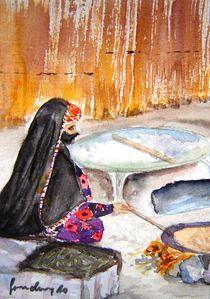 Beduinin beim Fladenbrot backen von sura