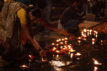 Lamps in the Ganges- 4  Varanasi,India by Soumen Nath