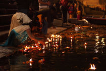 Lamps in the Ganges-6  Varanasi,India by Soumen Nath