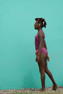 Caribbean girl in pink swimsuit by Victor Santamaria Gonzalez