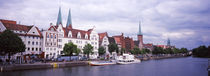 Buildings at the riverside, Trave River, Lubeck, Schleswig-Holstein, Germany by Panoramic Images