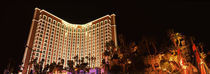 Low angle view of a hotel lit up at night, The Strip, Las Vegas, Nevada, USA by Panoramic Images