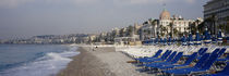 Empty lounge chairs on the beach, Nice, French Riviera, France by Panoramic Images