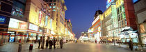 Shops lit up at dusk, Wangfujing, Beijing, China by Panoramic Images
