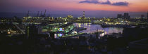 High angle view of city at a port lit up at dusk, Genoa, Liguria, Italy von Panoramic Images