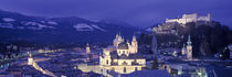 Austria, Salzburg, Aerial view of a city at night by Panoramic Images