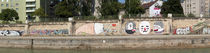 Graffiti on a wall at the riverside, Wien River, Vienna, Austria von Panoramic Images