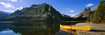 Canoe at the lakeside, Bow Lake, Banff National Park, Alberta, Canada by Panoramic Images