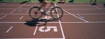 Low section view of a man cycling on sports track, Kirchzarten, Germany von Panoramic Images