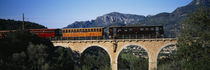 Train crossing a bridge, Sierra De Tramuntana, Majorca, Spain by Panoramic Images
