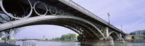 Low Angle View Of Isabel II Bridge Over Guadalquivir River, Seville, Spain by Panoramic Images