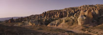 Rock formations on a landscape, Cappadocia, Turkey by Panoramic Images