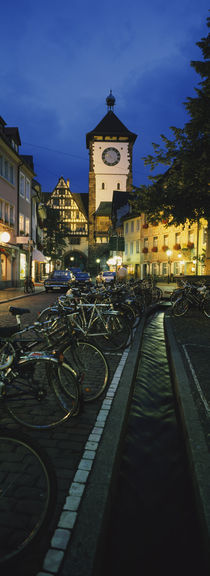 Bicycles parked along a stream near a road, Freiburg, Baden-Württemberg, Germany von Panoramic Images