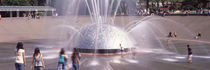 Children playing near a fountain, Seattle, King County, Washington State, USA by Panoramic Images
