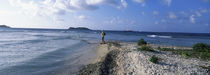 Tourist fishing on the beach, Sandy Cay, Carriacou, Grenada von Panoramic Images