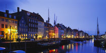 Buildings lit up at night, Nyhavn, Copenhagen, Denmark by Panoramic Images