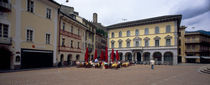 Group of people at a sidewalk cafe, Town Center, Bellinzona, Ticino, Switzerland by Panoramic Images