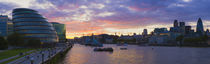 City hall with office buildings at sunset, Thames River, London, England by Panoramic Images