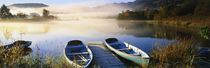 Rowboats at the lakeside, English Lake District, Grasmere, Cumbria, England by Panoramic Images