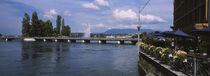 Bridge across a river, Rhone River, Geneva, Switzerland by Panoramic Images