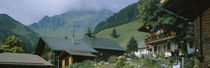 Low angle view of houses on a mountain, Muren, Switzerland by Panoramic Images