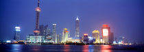 Buildings lit up at dusk, Shanghai, China von Panoramic Images