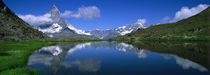 Reflection of mountains in water, Riffelsee, Matterhorn, Switzerland by Panoramic Images