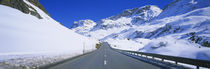 Empty road passing through a polar landscape, Route 3, Graubunden, Switzerland von Panoramic Images