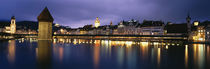 Buildings lit up at dusk, Chapel Bridge, Reuss River, Lucerne, Switzerland von Panoramic Images