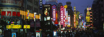 Group of people walking on the road, Nanjing Road, Shanghai, China by Panoramic Images