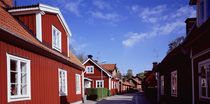 Houses on the both sides of a street, Trosa, Sweden by Panoramic Images