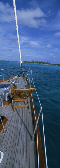Chair on a boat deck, Exumas, Bahamas by Panoramic Images