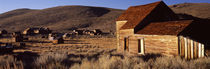 Abandoned houses in a village, Bodie Ghost Town, California, USA by Panoramic Images