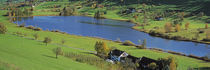 Lake Huttensee, Aerial view of cottages around a lake von Panoramic Images