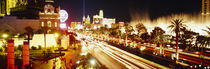 Buildings in a city lit up at night, Las Vegas, Nevada, USA by Panoramic Images