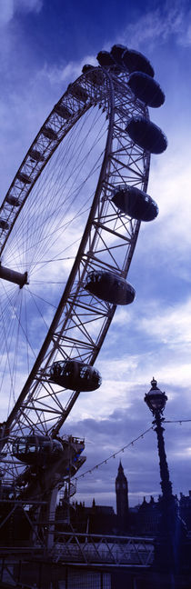 Low angle view of the London Eye, Big Ben, London, England by Panoramic Images