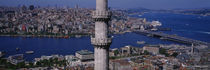 minaret with bridge across the bosphorus in the background, Istanbul, Turkey by Panoramic Images