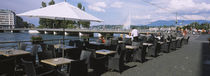 Sidewalk cafe at a riverbank, Rhone River, Geneva, Switzerland von Panoramic Images