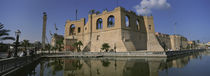 Reflection of a building in a pond, Assai Al-Hamra, Tripoli, Libya von Panoramic Images