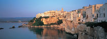 Buildings at the coast, Vieste, Gargano, Apulia, Italy by Panoramic Images