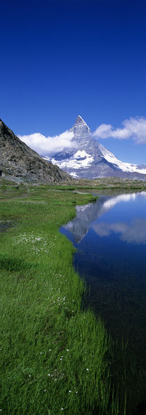 Reflection Of Mountain In Water, Riffelsee, Matterhorn, Switzerland von Panoramic Images