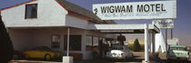 Cars parked in a hotel, Wigwam Motel, Route 66, Holbrook, Arizona, USA by Panoramic Images
