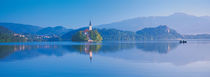 Reflection of mountains and buildings in water, Lake Bled, Slovenia by Panoramic Images