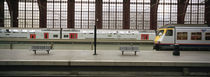 Trains at a railroad station platform, Antwerp, Belgium by Panoramic Images
