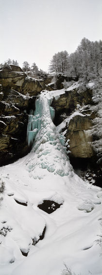 Low angle view of a frozen waterfall, Valais Canton, Switzerland by Panoramic Images