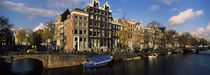 Buildings along a canal, Amsterdam, Netherlands by Panoramic Images