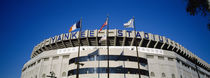 Flags in front of a stadium, Yankee Stadium, New York City, New York, USA by Panoramic Images