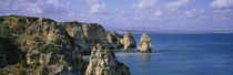 Rock formations on the beach, Lagos, Algarve, Portugal by Panoramic Images