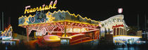 Neon sign lit up at night, Oktoberfest, Munich, Bavaria, Germany by Panoramic Images