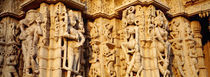 Sculptures carved on a wall of a temple, Jain Temple, Ranakpur, Rajasthan, India by Panoramic Images